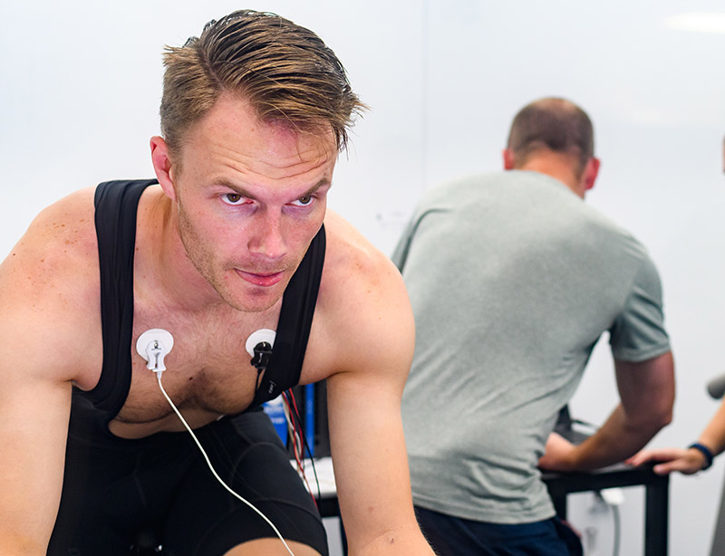 man with heart monitors exercising