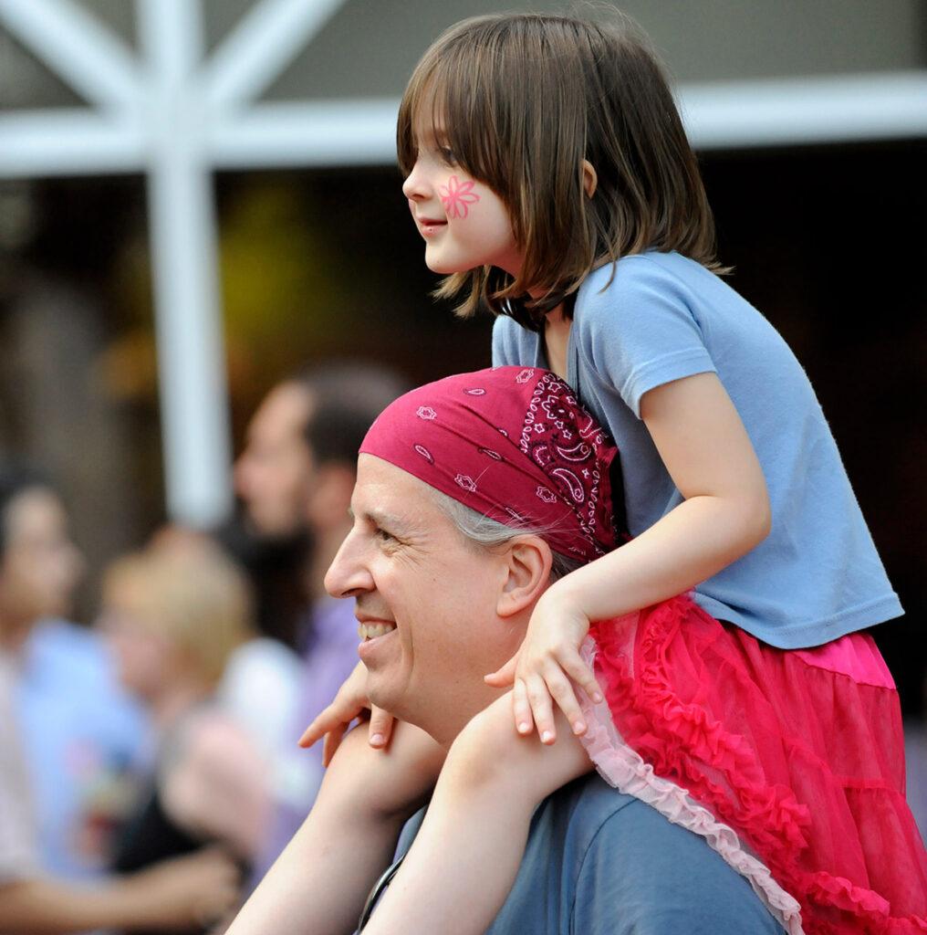 child on parent's shoulders